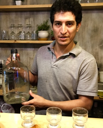 Leo with a jug of homemade Pisco
